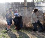 Rose Garden Club and Boy Scouts Help Clean Up